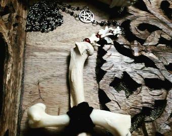 Inverted bone crucifix