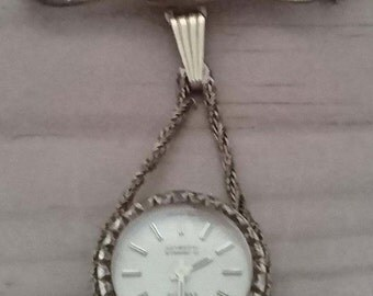 Vintage Everite suspended watch