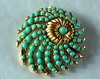 Wonderful Crown Trifari design and color in this swirling domed brooch, belly chain, jewlery.