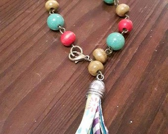 Tassel bracelet with wood and ceramic beads