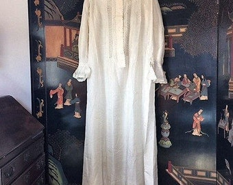 VICTORIAN NIGHTGOWN. All white, translucent silk. The gown is finished with lovely lace insets on the front, cuffs and  collar.