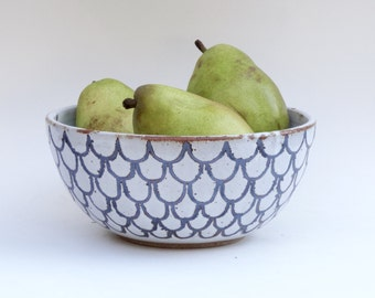 Handmade ceramic serving bowl in gloss white with iron-oxide design