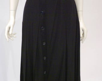 Black pleated skirt by Celine, large size, 1980s