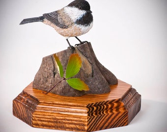 A Hand-carved Wooden Chickadee sits on a stump next to a wild strawberry leaf. Art,Sculpture,Home Decor, Wooden Bird, Chickadee