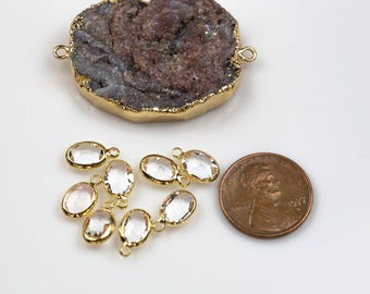 Petite tiny crystal charms 6*8mm. Clear crystal Ovals bezeled with gold plated copper / brass. 8 pieces.