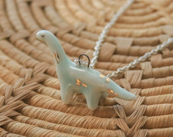 handmade ceramic brontosaurus totem pendant