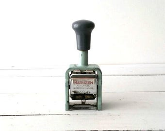 Awesome vintage industrial office enumerator stamp