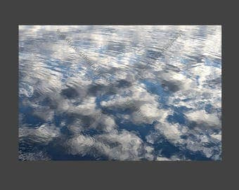 Digital Photo Download Blue Sky and White Clouds Reflection in Rippled Water Surface, Semi Abstract Nature Picture Stock