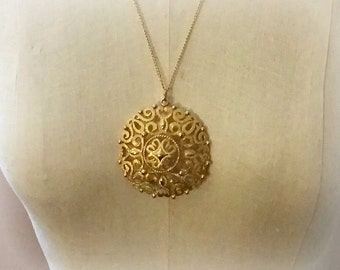 1970s Medallion Necklace big ornate textured dome pendant gold tone, 24 inch chain vintage costume jewelry