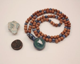 XLB Glass Collab! Sandalwood and Kyanite 108 bead mala with blown borosilicate glass encapsulated kyanite shard.