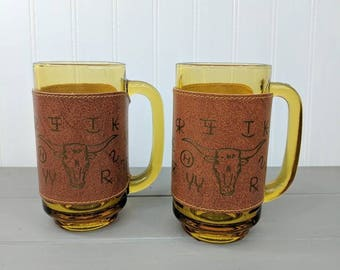 2 Vintage Vegan Leather Removable Covered Amber Mugs Decorated with Cattle Brands, Vintage Amber Steins with Handles