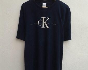 4 james CALVIN KLEIN Jeans Chest Logo Graphic CK Streetwear Vintage 90s T-Shirt Size L