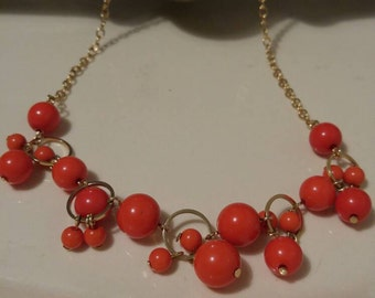 Avon gold tone and faux coral beaded necklace est.1970s