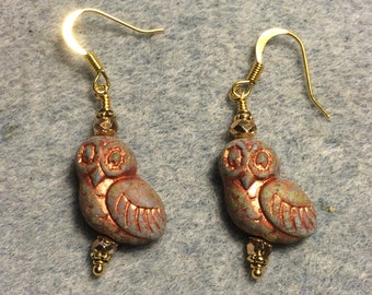 Green with copper wash fancy Czech glass owl bead earrings adorned with gold Chinese crystal beads.