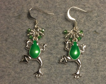 Silver and green enamel frog charm earrings adorned with tiny dangling green and clear Chinese crystal beads.