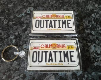 Back to the Future Keyring and Magnet Set. Outatime Delorean License Plate