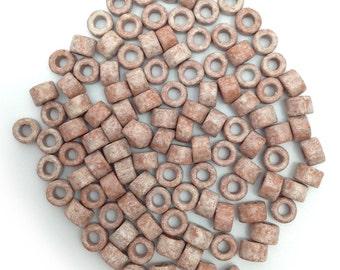 Ceramic cylinder, white Brown speckled, 6 mm, 100