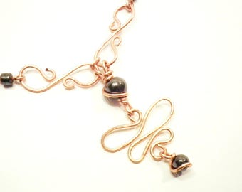 Hematite wire wrapped swirling copper necklace