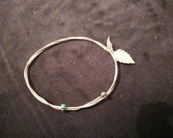 Guitar string steel bracelet with detail