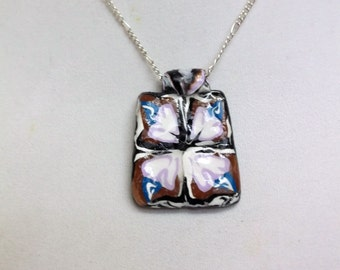 Matching tile pendant in purple, blue, white, and brown. Resin finish, silver chain.