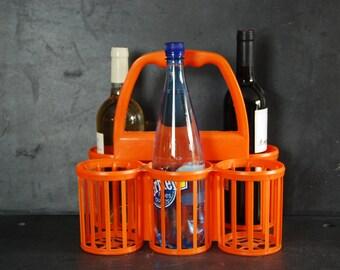 French vintage orange  plastic bottle carrier or bottle holder, 1960s. Very retro, vintage interior. Man cave collectable.
