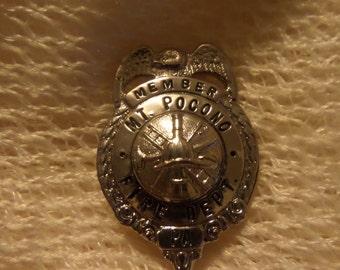 Vintage Pennsylvania Pocono Lancaster Fire Department badge buttons or pins