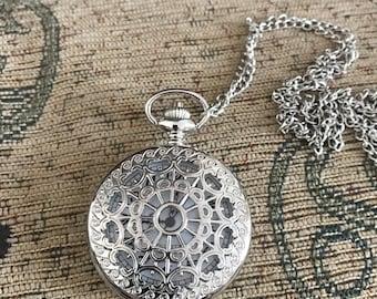 Silver spider web pocket watch