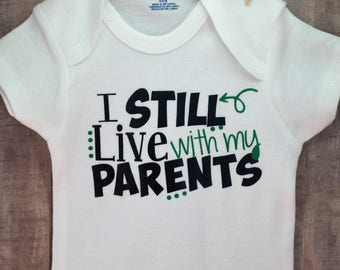 I Still Live With My Parents Funny Newborn Baby Girl Boy Toddler Clothes Rompers Baby Shower Birthday Gift Idea Coming Home Tee Shirt