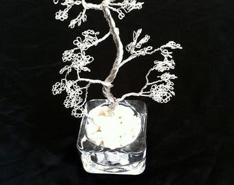 Silver plated wire bonsai tree in a glass dish filled with stones