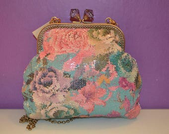 Printed canvas bag with small sequins and kiss clasp