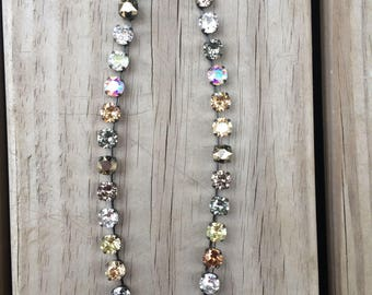Swarovski crystal necklace - mix of browns, golds, black, crystals. Customer favorite!