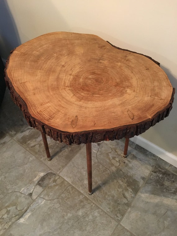 Maple end/decorative table w/copper legs. Sliced with unique tap markings. Michigan grown & made. Fundraiser benefits woodshop class.