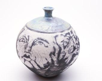 Lively Faces a RAKU vase