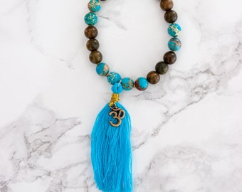 Handmade, one-of-a-kind Bracelet with Lapis Lazuli, Sandalwood & Om Charm