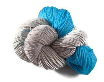 Luxury hand dyed 4 ply merino - nylon sock yarn. Indie dyer. Silver grey and turquoise. Elegant Ladybells. 100g. 400m.