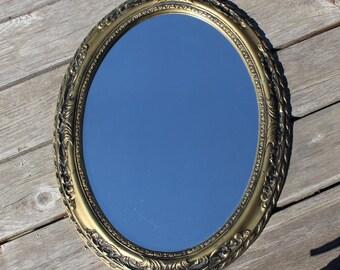 """Vintage Gold Black Oval Wall Mirror Ornate Carved Look Ornate Molded Plastic Frame Hollywood Regency Vintage 17.5"""" x 23"""