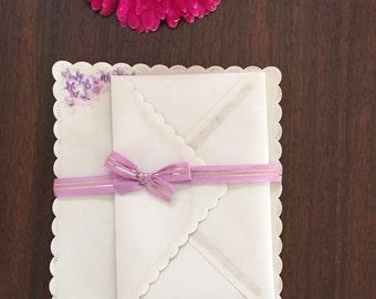 Scattered violets/vintage writing sheets