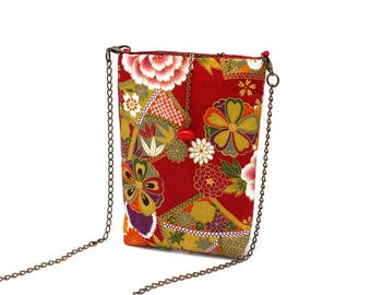 Red smartphone bag patterned with white and pink flowers