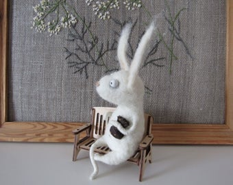 Cute little Rabbit. White Easter Bunny. The toy is made of wool. Gift. Cute Bunny.