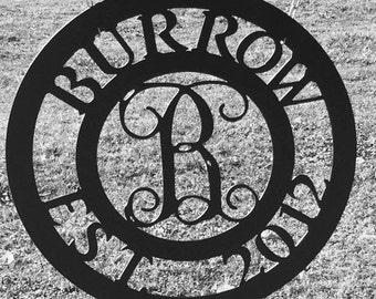 Metal monogram sign, vine font