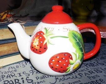Vintage (c.1980s) Strawberry Patch teapot designed by Classic Giftware Inc.  Too cute with HUGE strawberries, green leaves and text.