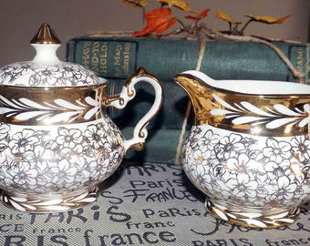 Mid-century (1950s) Gibsons England W989 hand-decorated, gold lusterware cream and covered sugar bowl. Gold floral chintz, white leaves.