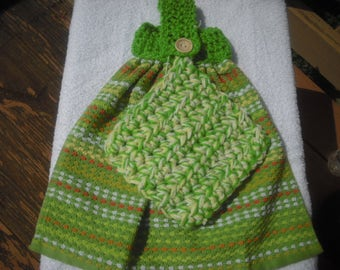 Green striped hand crocheted top kitchen towel with a matching pot holder.