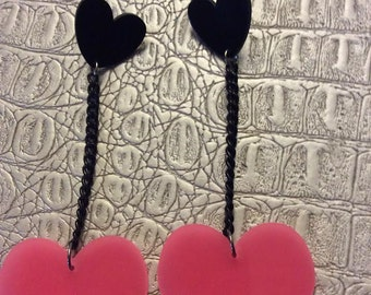Extra long black and pink hart resin earrings