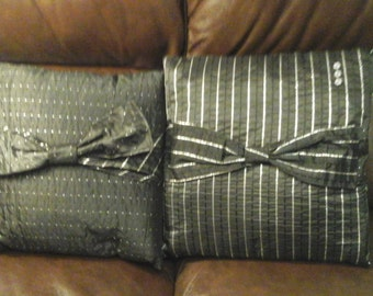 Pair of bow cushions