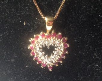 Gold tone sterling silver ruby heart. 18 inch necklace