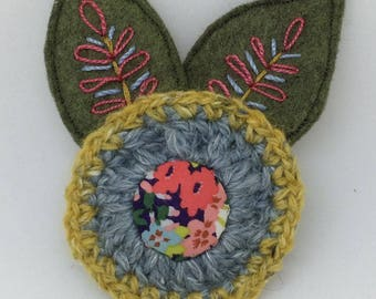 Crochet and hand embroidered felt flower brooch