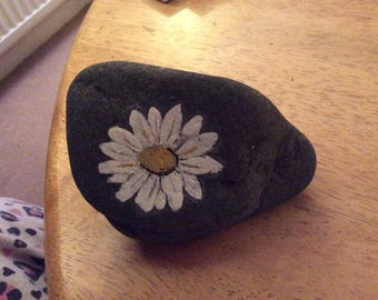 Hand painted daisy on scottish rock.