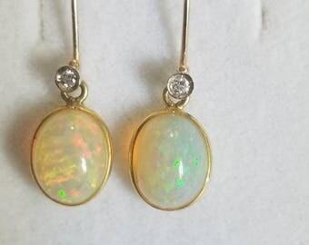Opal and diamond earrings in 18k gold