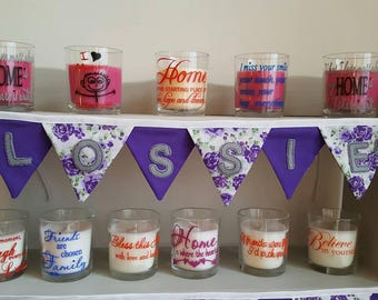Decorated candles in glasses